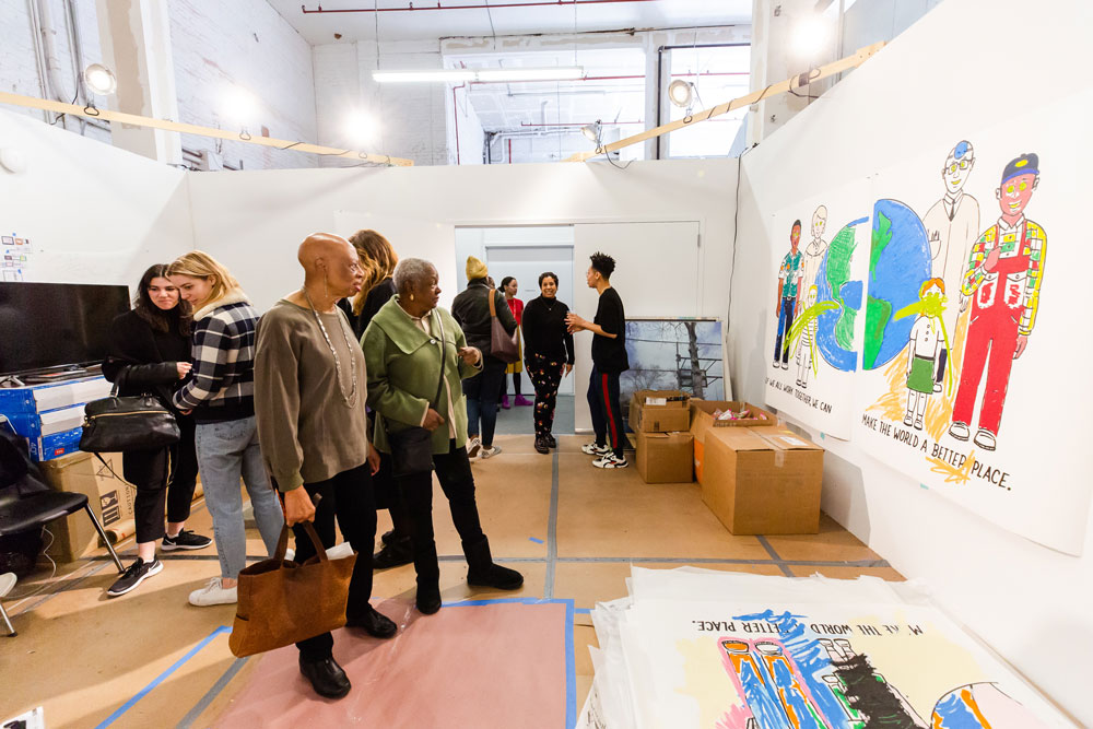 A crowd gathers in Sable Elyse Smith's studio.