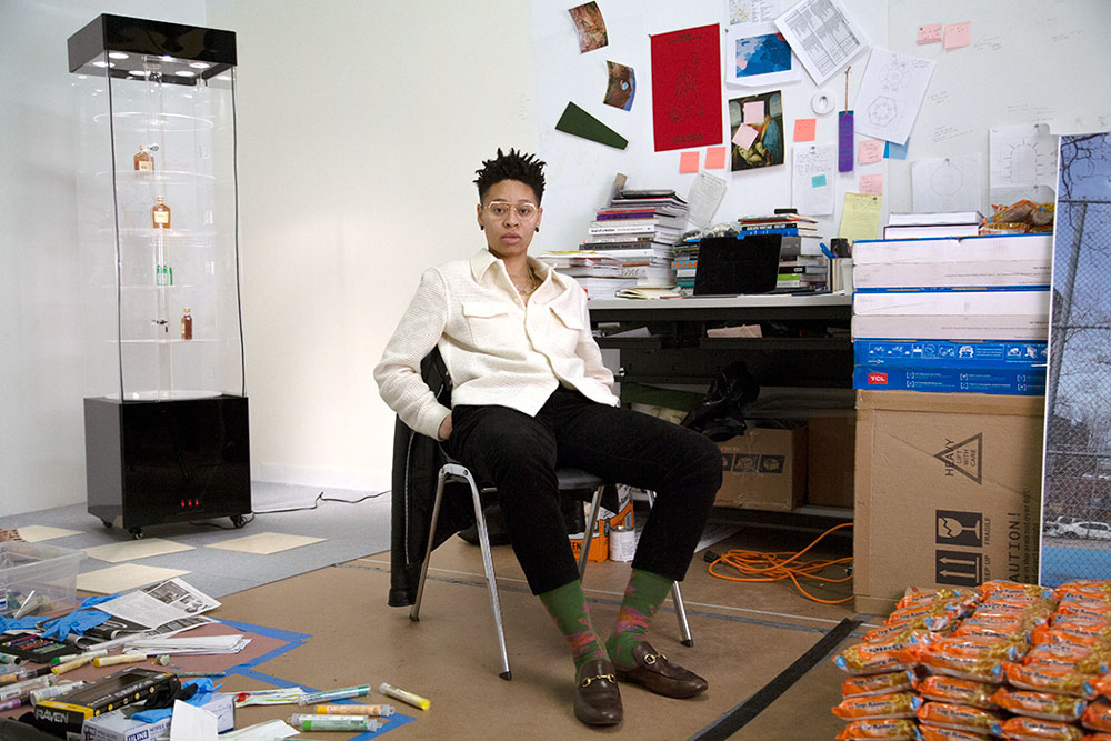 Sable Elyse Smith sits in their studio.