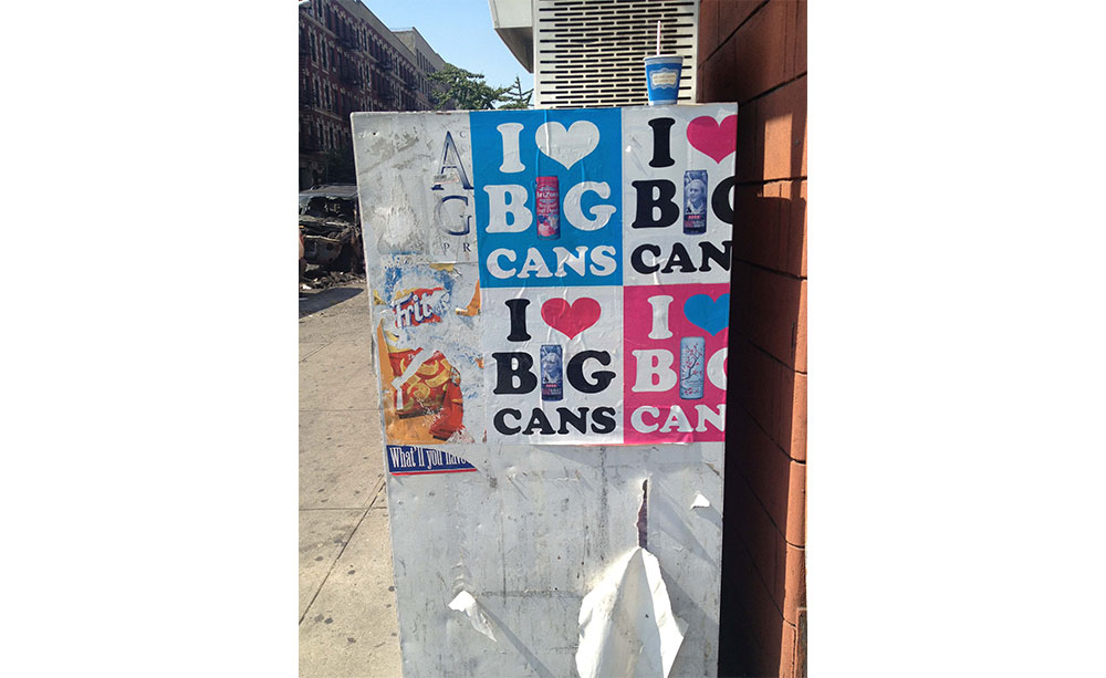 Pasted advertisements for I heart big cans.