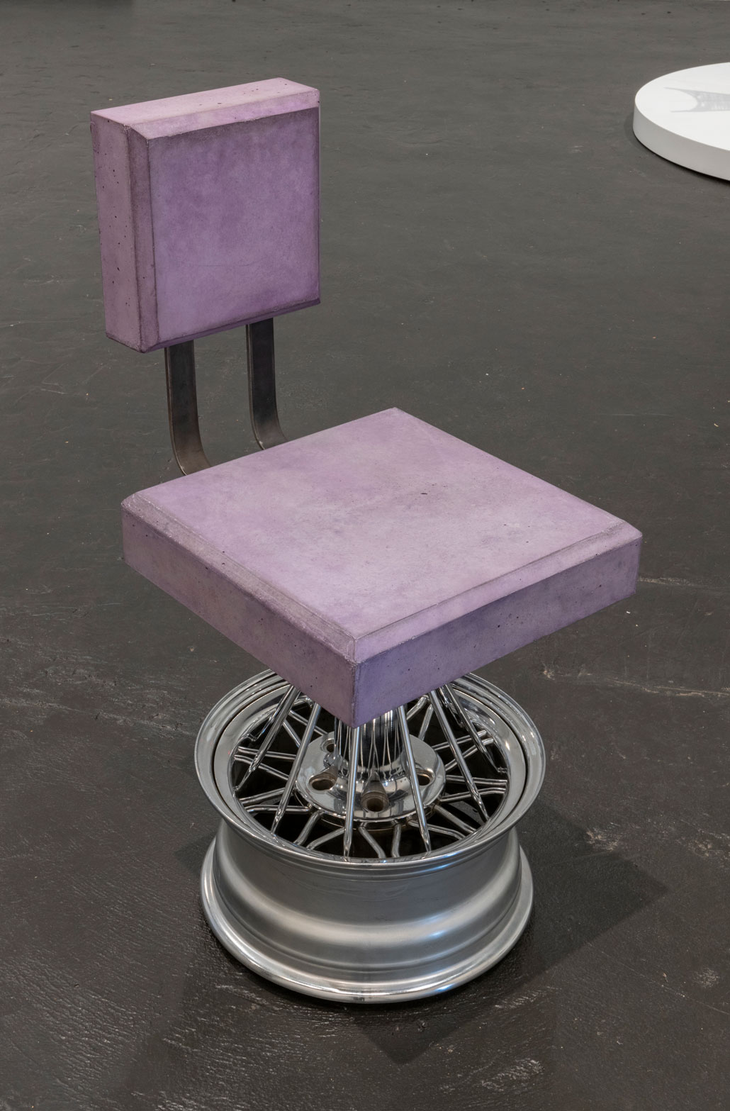 Purple and metal chair with no arms on metallic base